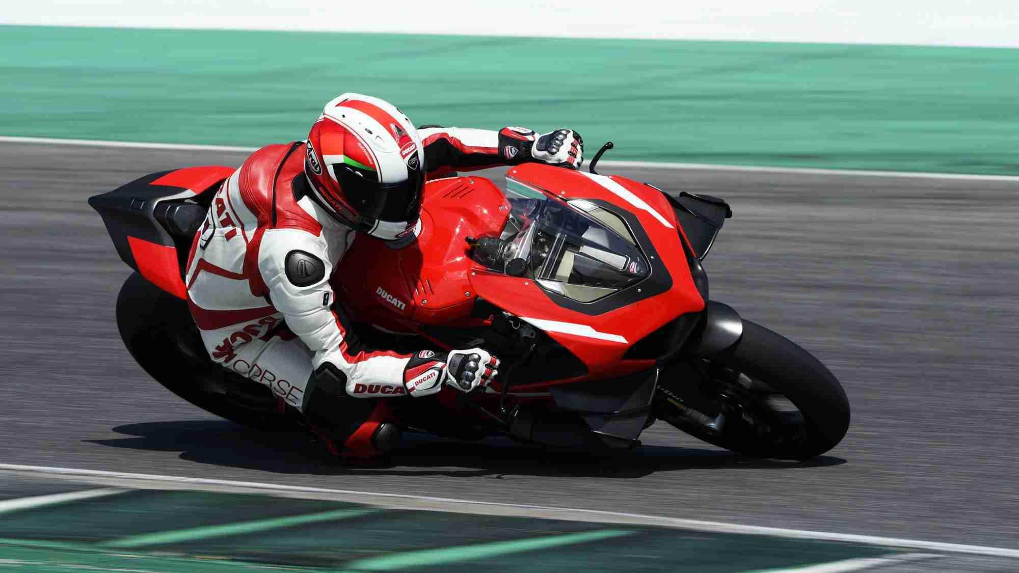 Claudio Domenicali riding the Ducati Superleggera V4